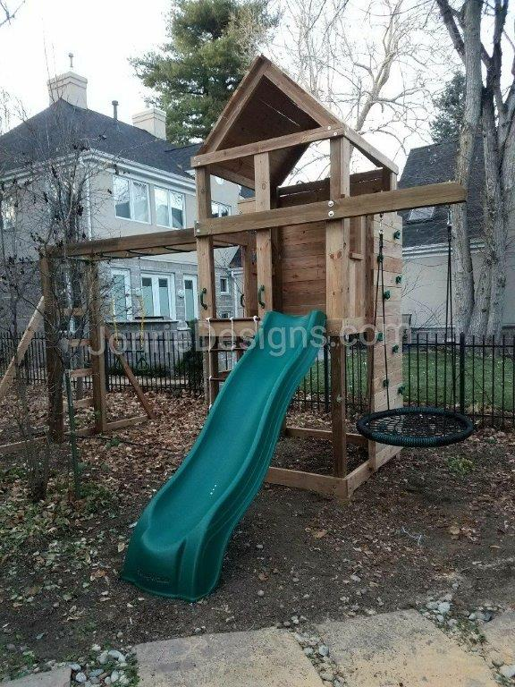 5'x5' Clubhouse with wooden roof, Enclosed back wall, 5' Deck height, 5' Standard slide, 2' Cargo net, 8' Climbing wall, 8' Monkey bars with dual ladders, Trapeze bar, 3' Cantilever with Web swing