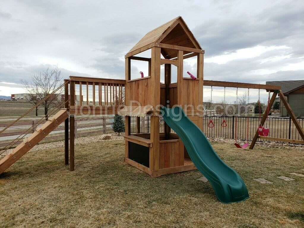 5'x5' Clubhouse with wooden roof, 5' Deck height, 2'x8' Bridge with Ramp, 5' Standard slide, Enclosed bottom with floor, Lemonade stand, 12' Swing beam with pink bucket swing, swing, rings, telescope & periscope