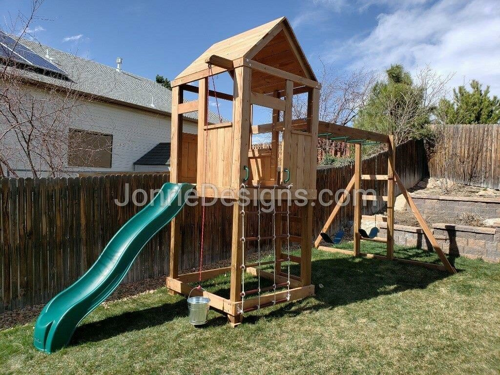 5'x5' Clubhouse with wooden roof, 5' Deck height, 5' Standard slide, 3' Cargo net, Drop down bucket, 8' Monkey bars with dual ladders & 2 Standard swings