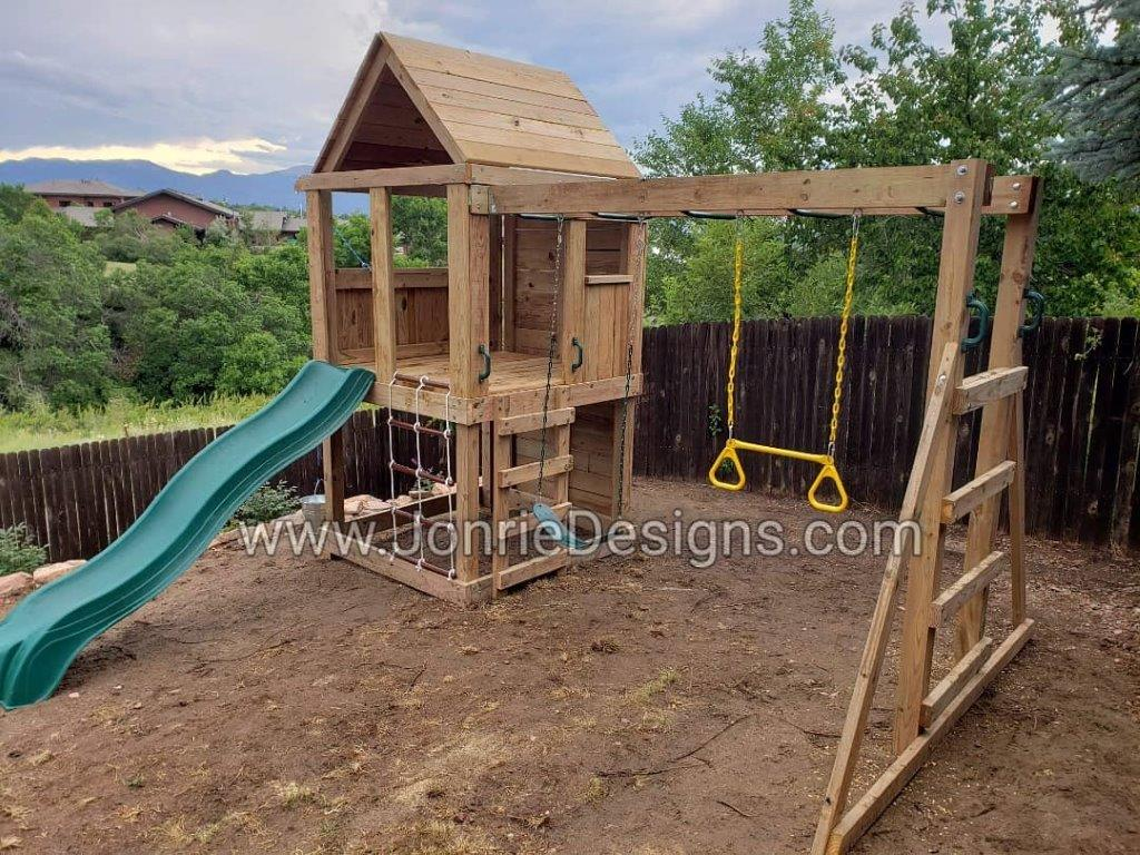 5'x5' Clubhouse with wooden roof, 4' Deck height, 4' Upgraded slide, 2' Cargo net entry, 8' Climbing wall (non-entry), Drop down bucket, 8' Monkey bars with dual ladders, Standard swing & trapeze bar.