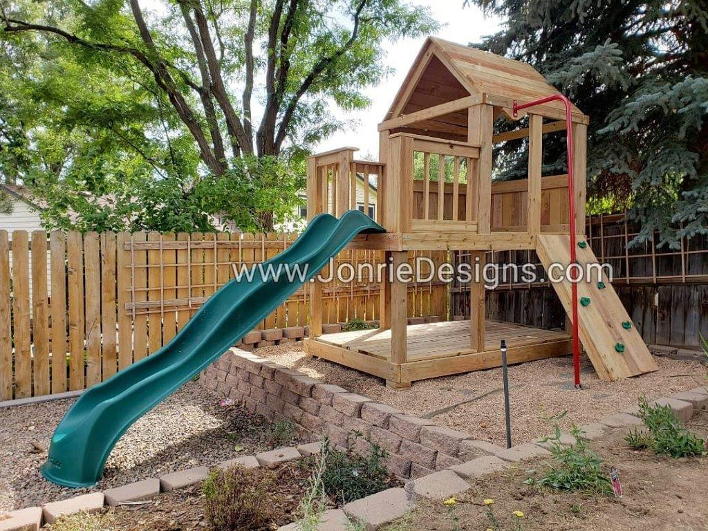 5'x5' Clubhouse with wooden roof, 3'x5' Uncovered porch with baluster rails (total 5'x8' footprint), Floor on bottom, Rock wall entry, Fireman pole & 5' Upgraded slide (needed for tier).