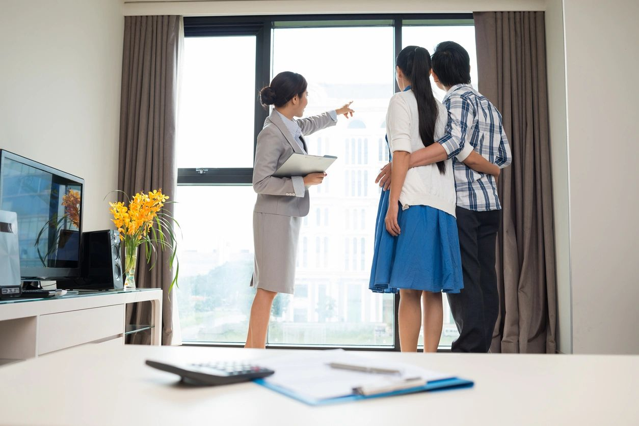 Realtor showing home to new couple