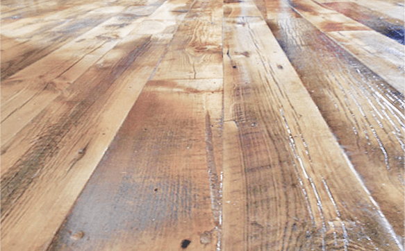 Reclaimed wood flooring with a rustic finish.