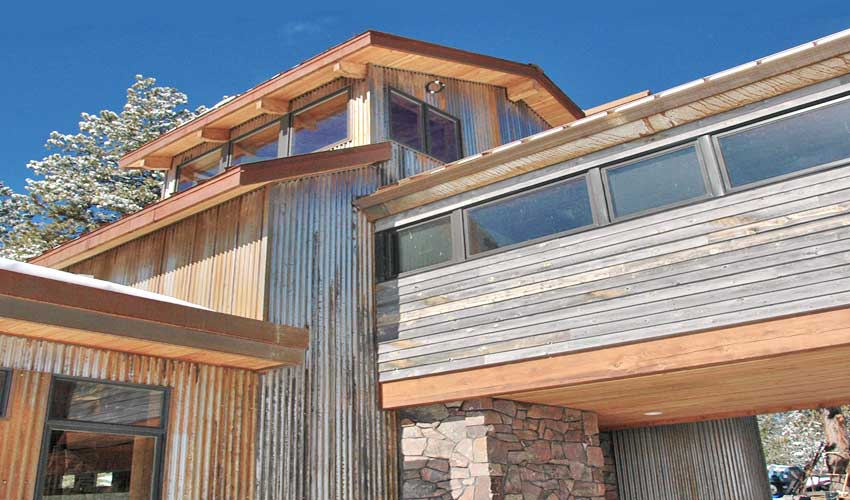 Grey reclaimed wood home exteriors bring out texture and depth.