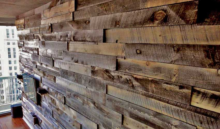 This biophilic reclaimed wood shows off its texture and depth on an interior loft wall.