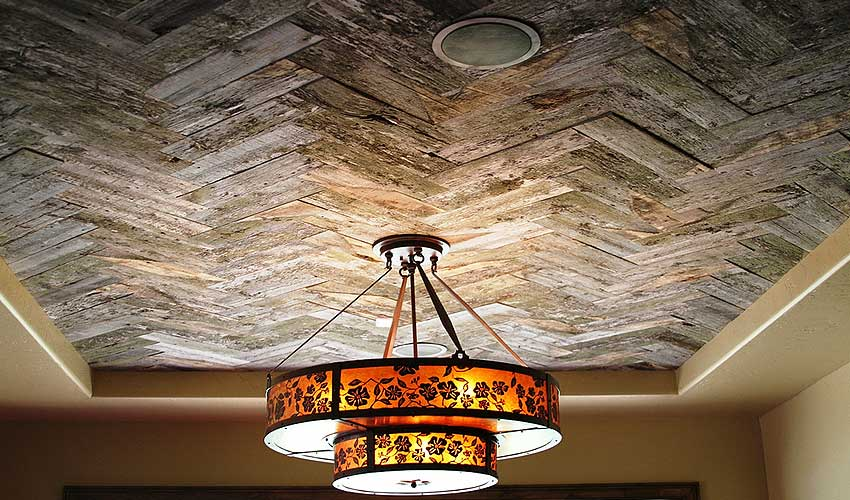 Grey wood, salvaged wood, and reclaimed wood is often used by top designers to create unforgettable ceilings.