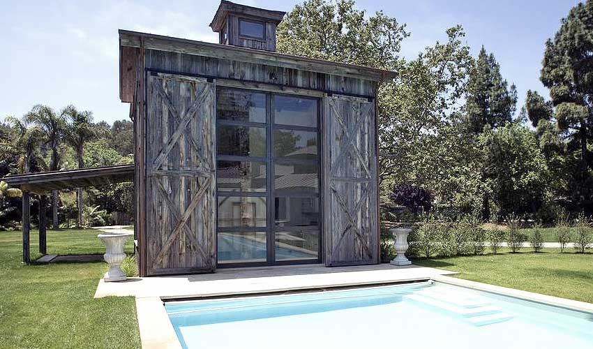 Grey reclaimed wood home exteriors bring about warm depth and cool tones.