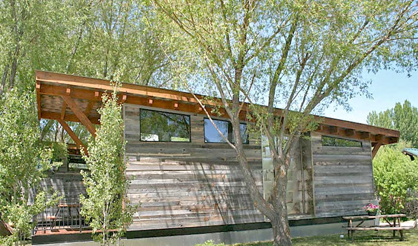 Grey reclaimed wood has a character of weathered perfection and looks fantastic on tiny homes.