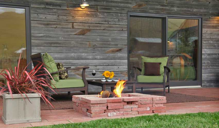 Grey reclaimed wood siding gives a home exterior an air of serenity.
