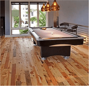 Buy reclaimed wood flooring.