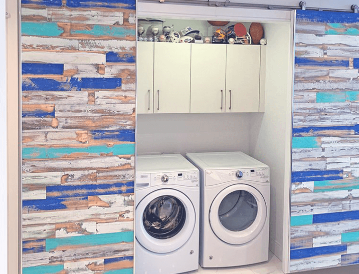 Painted wood paneling in the Wind River finish featuring reclaimed wood in blues.