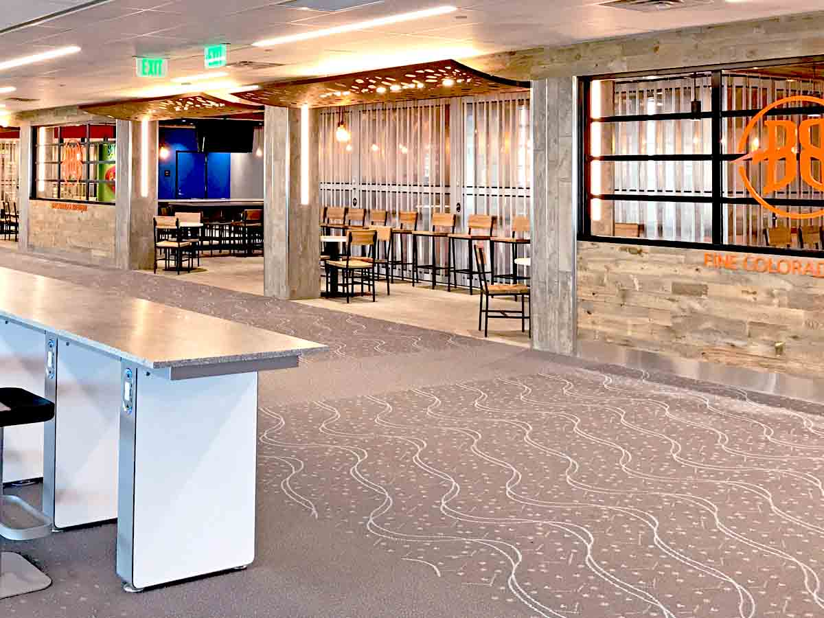 Biophilic design element of reclaimed wood paneling used at Denver International Airport