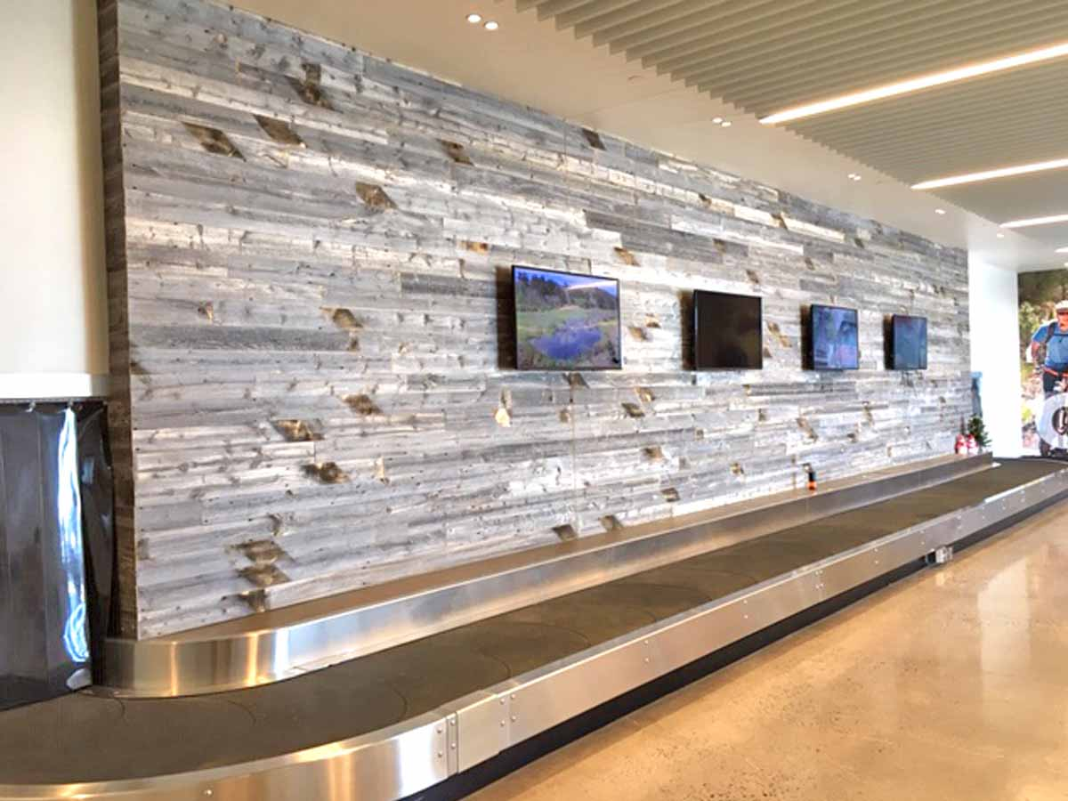 Reclaimed wood wall designs at the Cheyenne Airport baggage claim.
