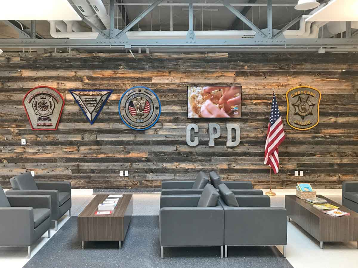 Reclaimed wood wall designs in a governmental and municipal spaces.