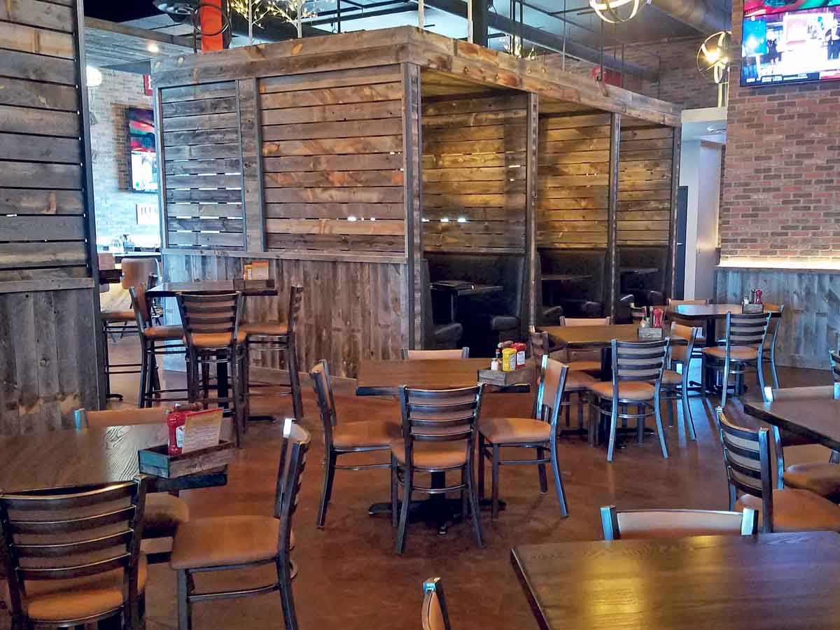 Creative use of reclaimed wood planks from Centennial Woods at Cunningham's Journal in Kearney, NE.