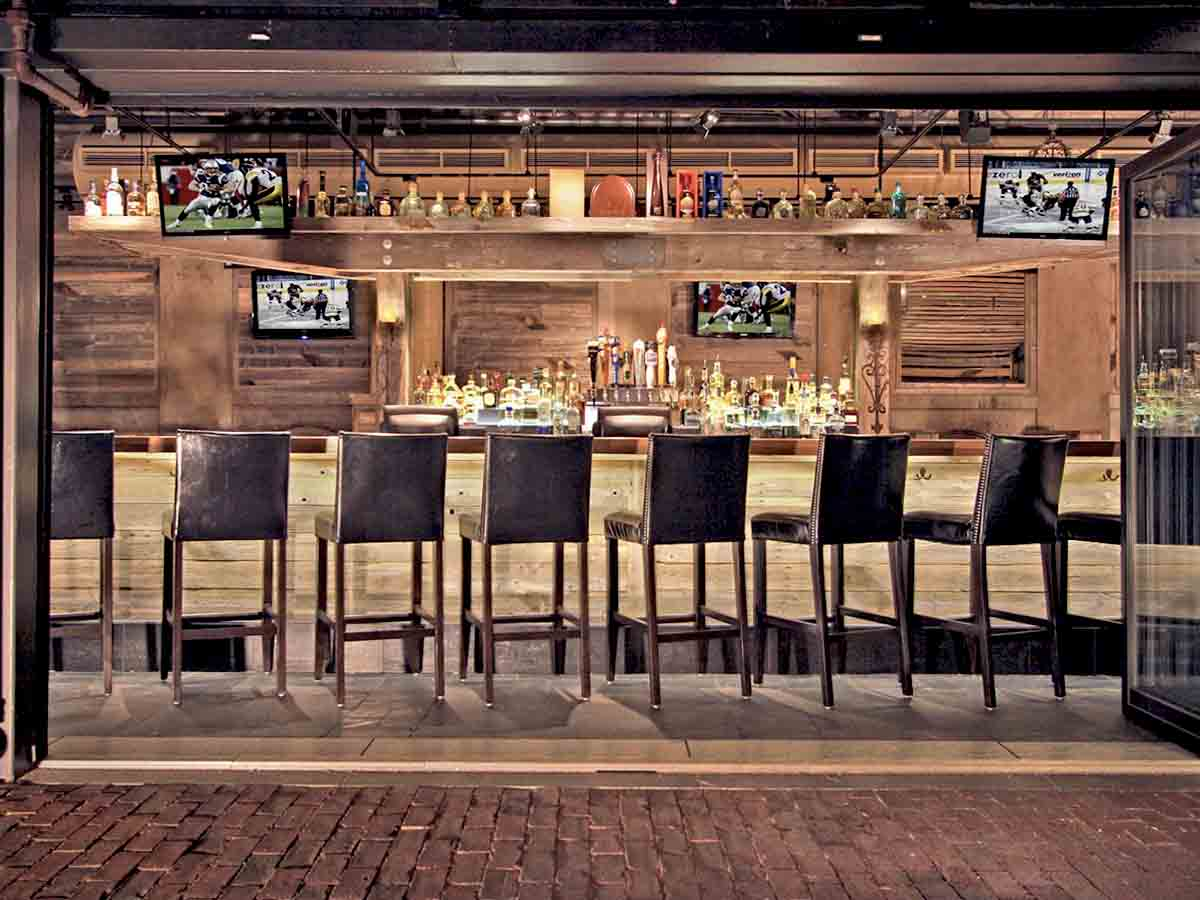 Reclaimed wood wall designs as an interior design element at Mija Cantina.