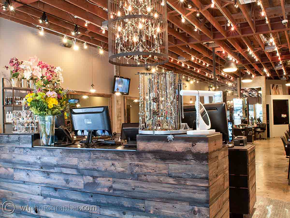 Reclaimed wood wall designs on a counter in a salon.