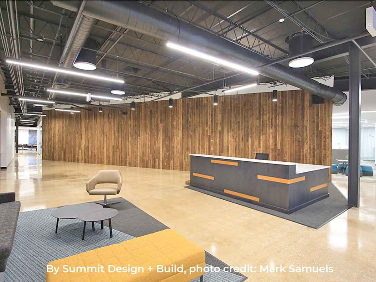 Vertical reclaimed wood wall designs in a corporate space.