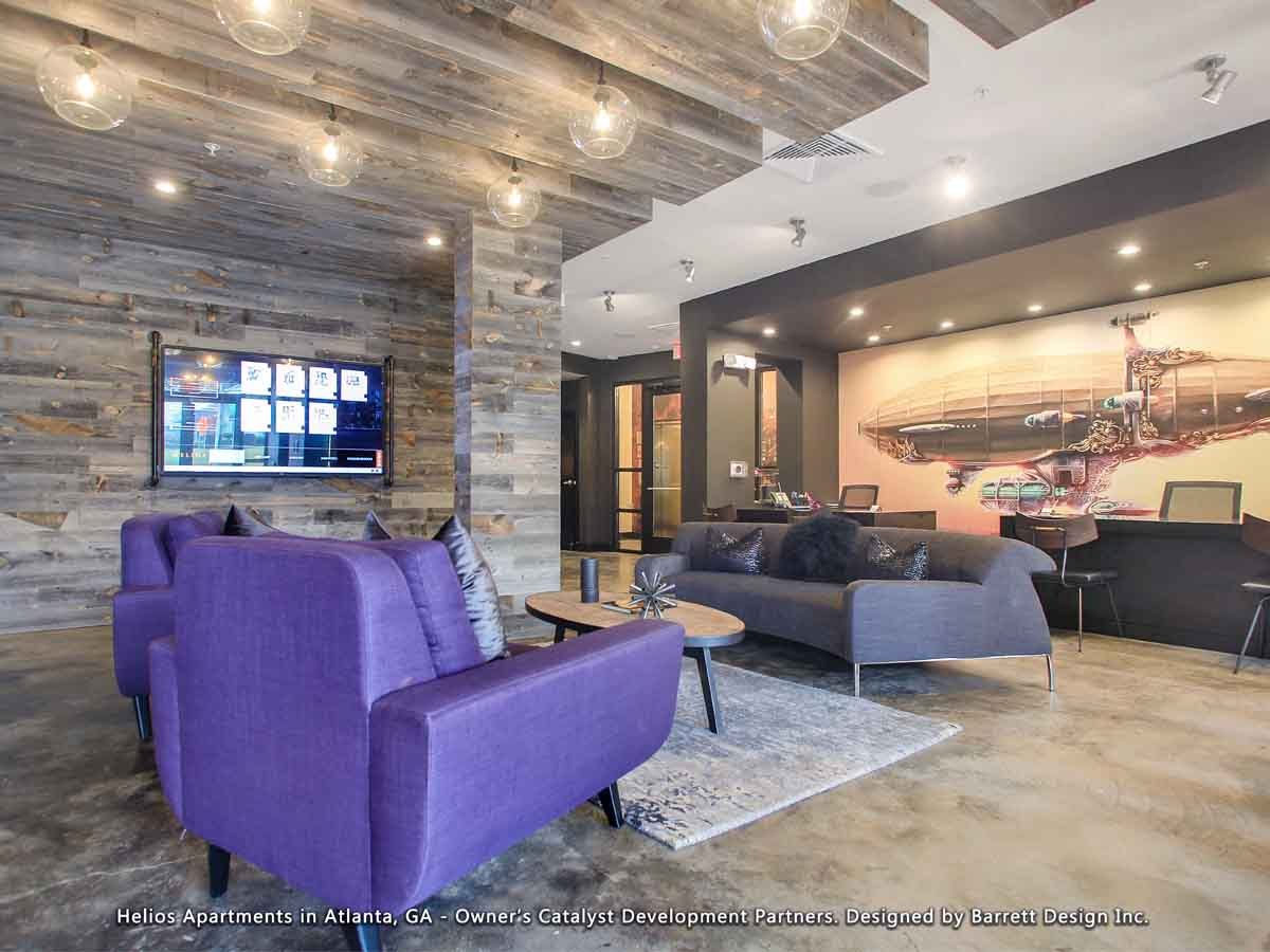 Reclaimed wood wall designs used as a biophilic design element in an apartment building lobby in Georgia.