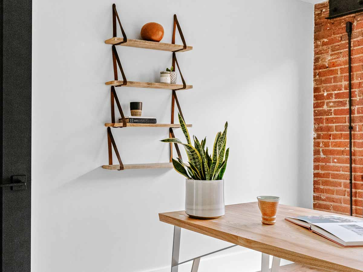 Brown reclaimed wood wall decor leather strap shelves by Centennial Woods and Range Leather