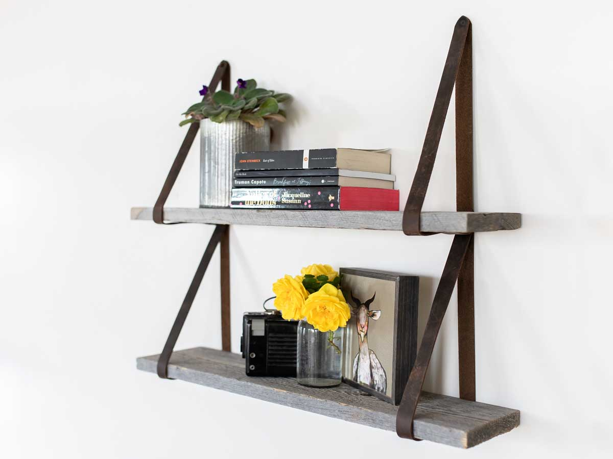 Reclaimed wood wall decor leather strap shelf by Centennial Woods.