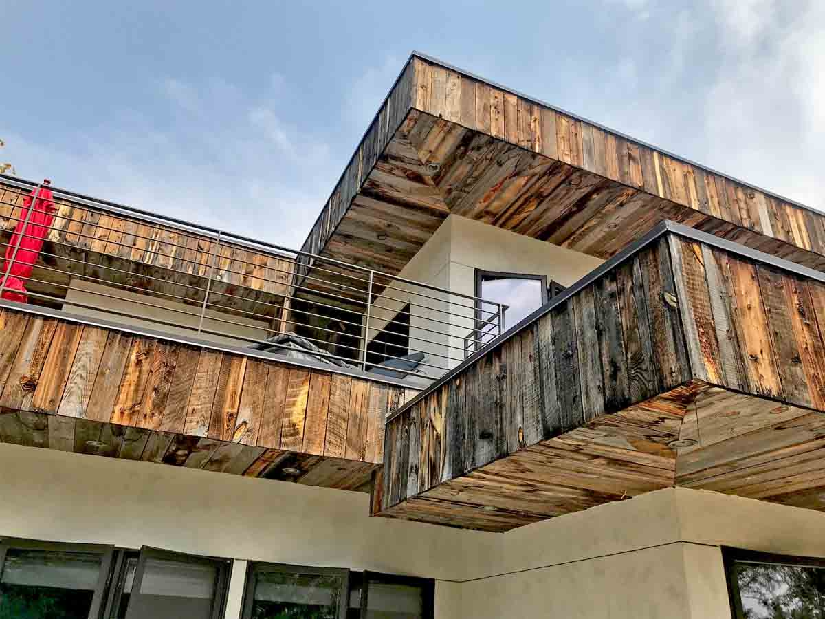 Reclaimed wood siding, soffits, and fascia on a home in Boulder, CO.