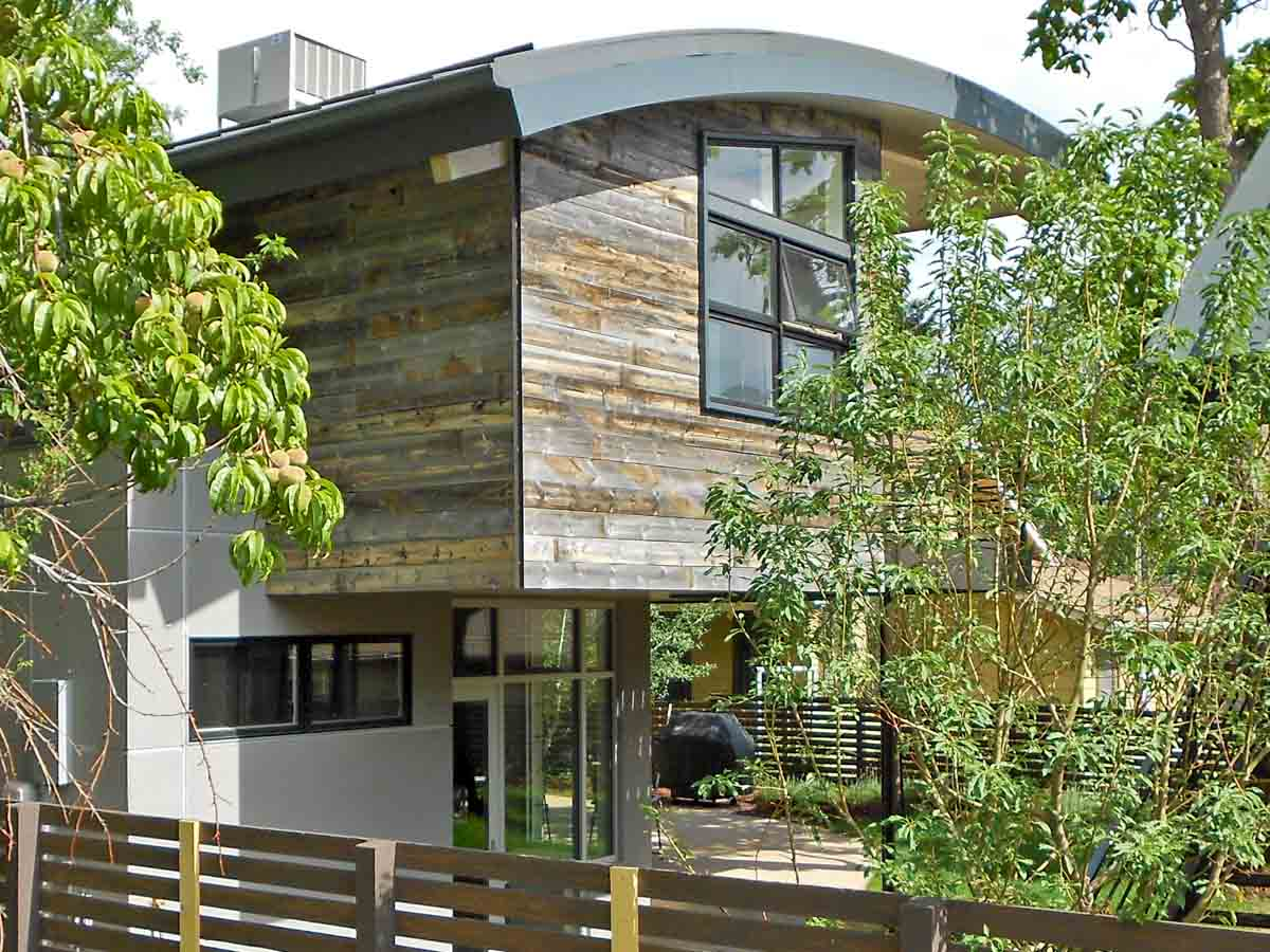 Modern home with rustic elements including reclaimed wood siding from Centennial Woods in Denver, CO