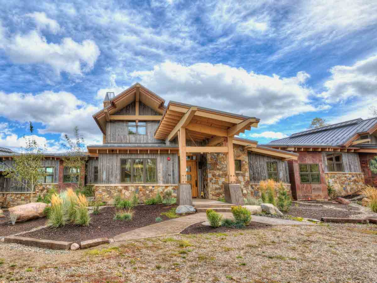 Home in Steamboat Springs, CO with reclaimed wood siding from recycled snow fence planks.