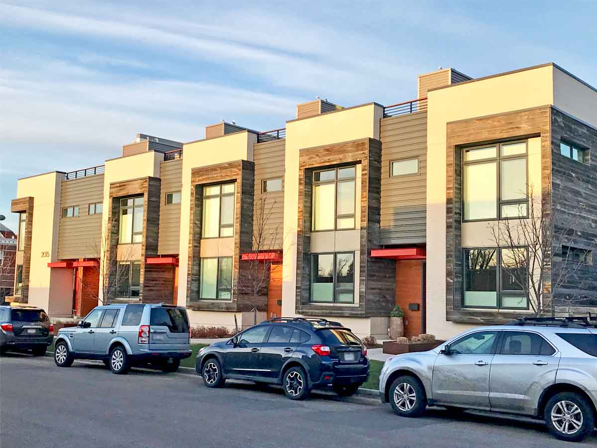 Reclaimed wood facade as an architectural design element on an apartment building in Bouler, CO.