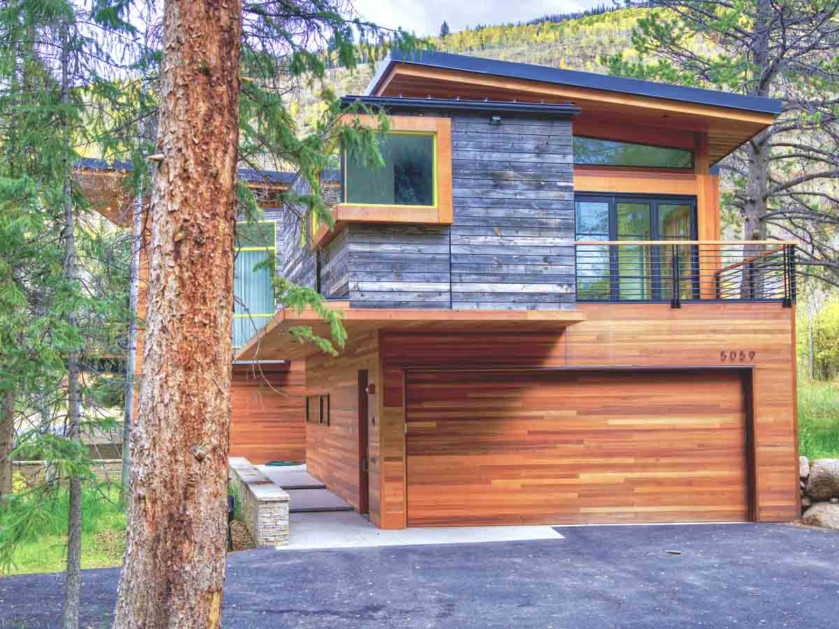 Modern rustic architecture featuring reclaimed wood siding by Centennial Woods near Vail, CO.