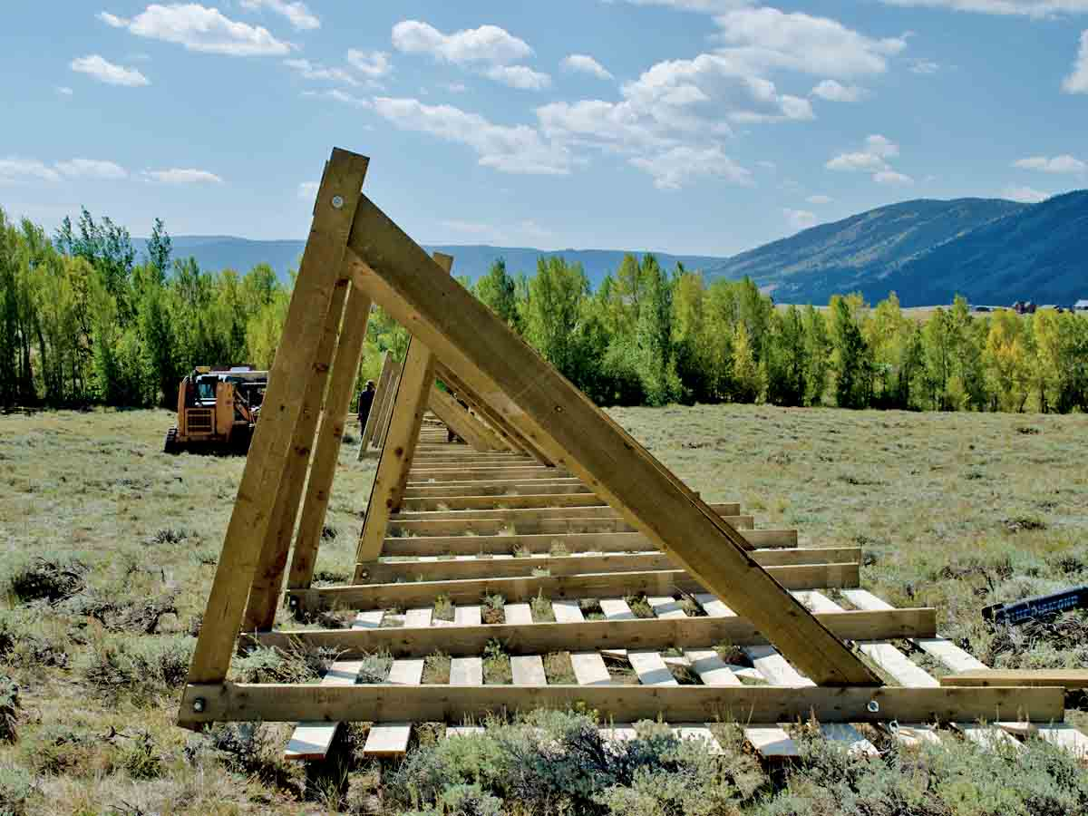 A brand new snow fence being installed in Centennial, WY in the foothills of the Snowy Range in the Medicine Bow National Forest.