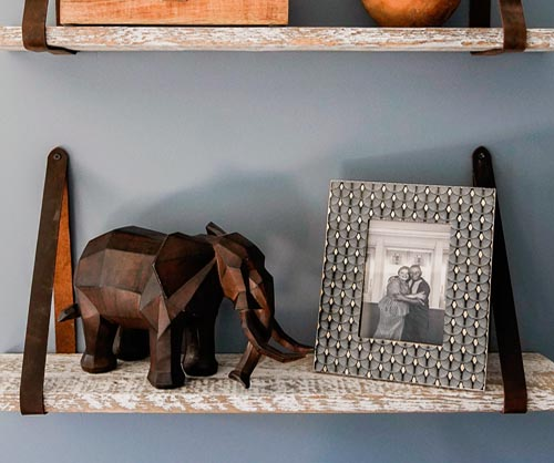 Leather strap reclaimed wood shelf as seen on HGTV's Extreme Makeover Home Edition.