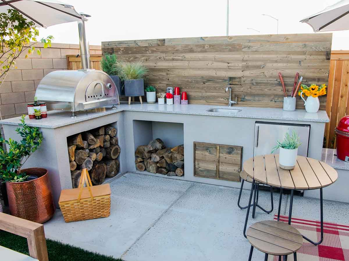 Extreme Makeover Home Edition outdoor kitchen with reclaimed wood.