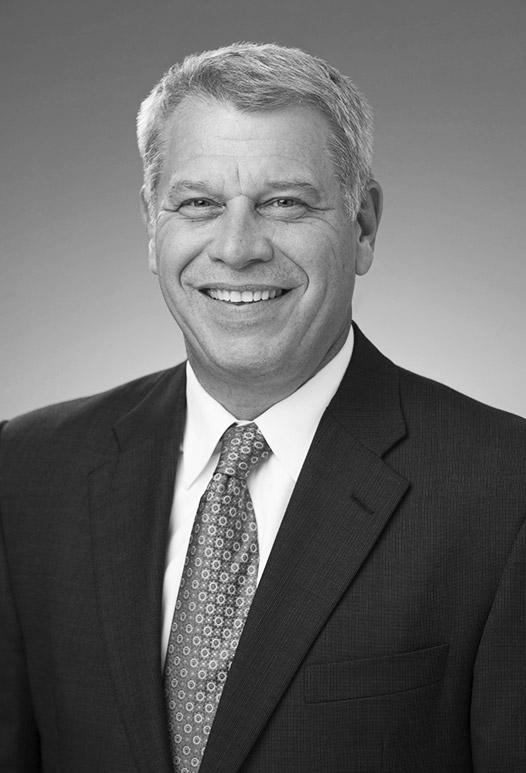 Mark J. Gerencser : Chairman