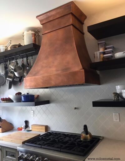 copper kitchen hood curved face