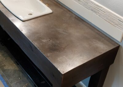 volcanic stainless steel countertop with steel rivets