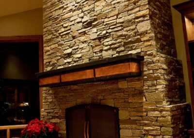 copper and steel fireplace mantel
