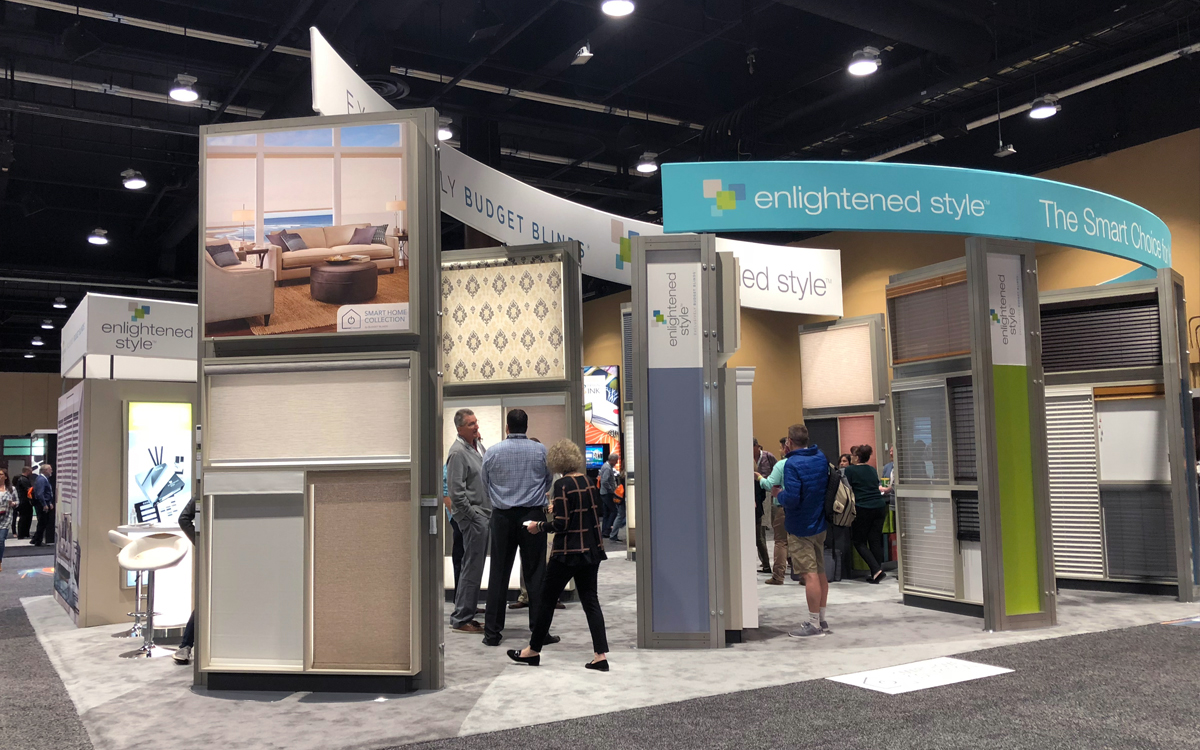 Curved fabric wrapped header above custom built product displays for Budget Blinds' trade show booth exhibit