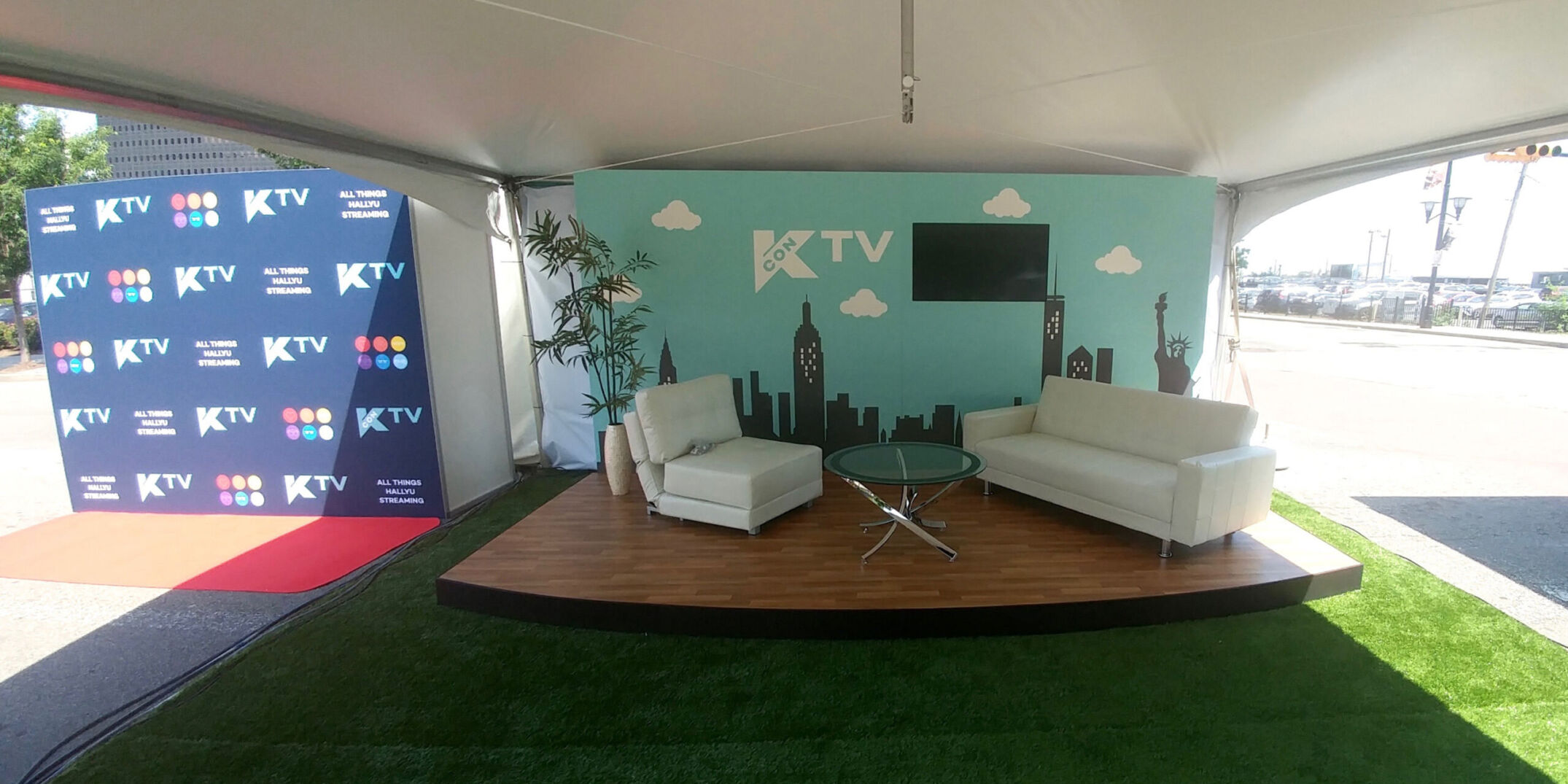 Outdoor TV set stage for Kcon inside tent with graphic wall for intros