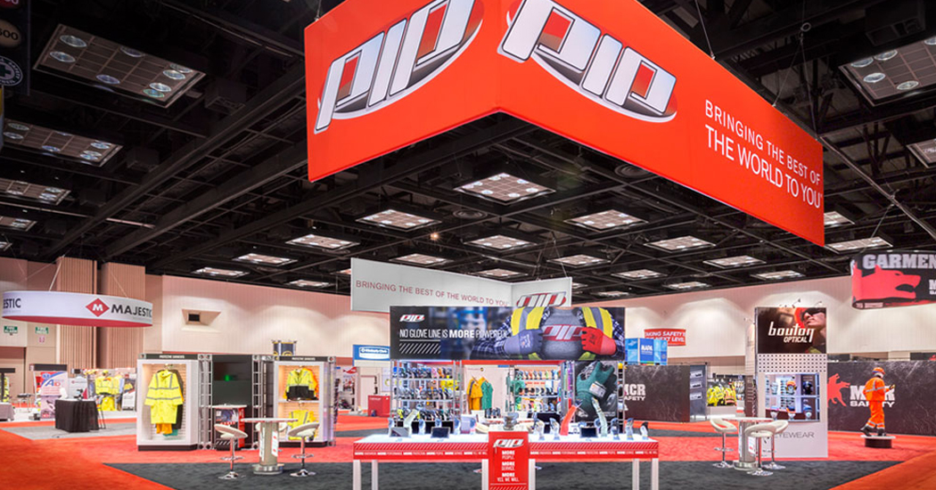 PIP trade show exhibit booth with hanging signs and display pods