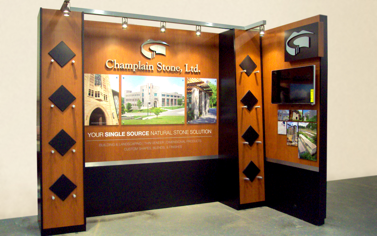 Trade show booth exhibit for Champlain Stone with track lighting, monitor and graphics