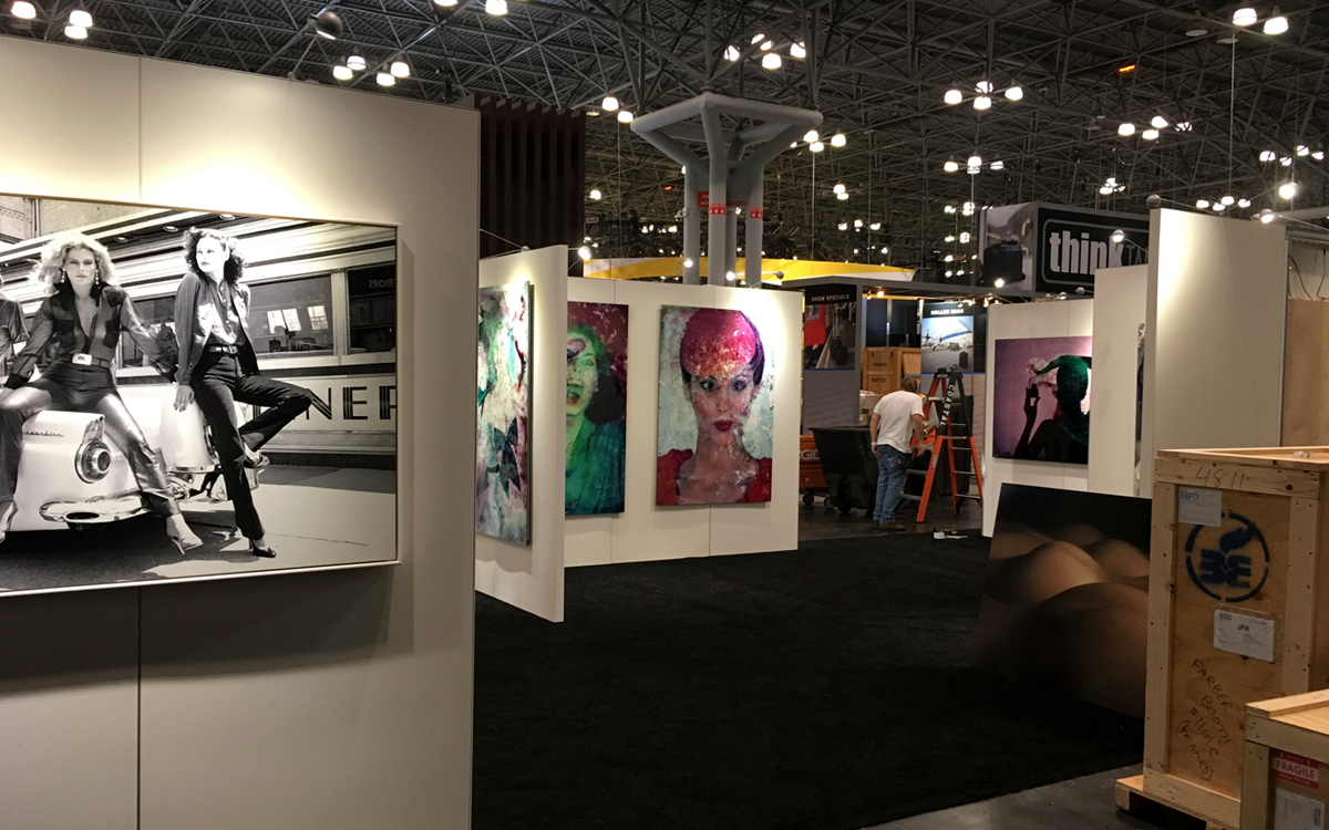 Artwork hanging on custom rental walls at the Chromalux show in NYC