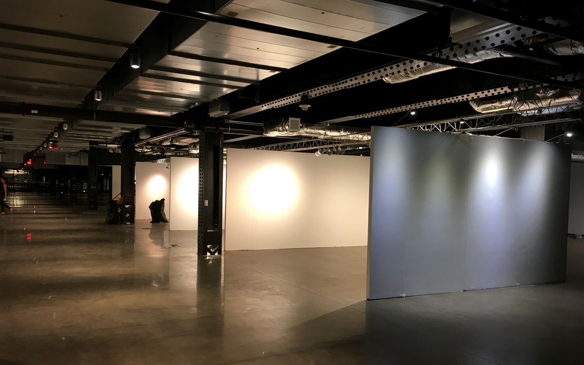 Gallery wall rentals with truss lighting in urban setting