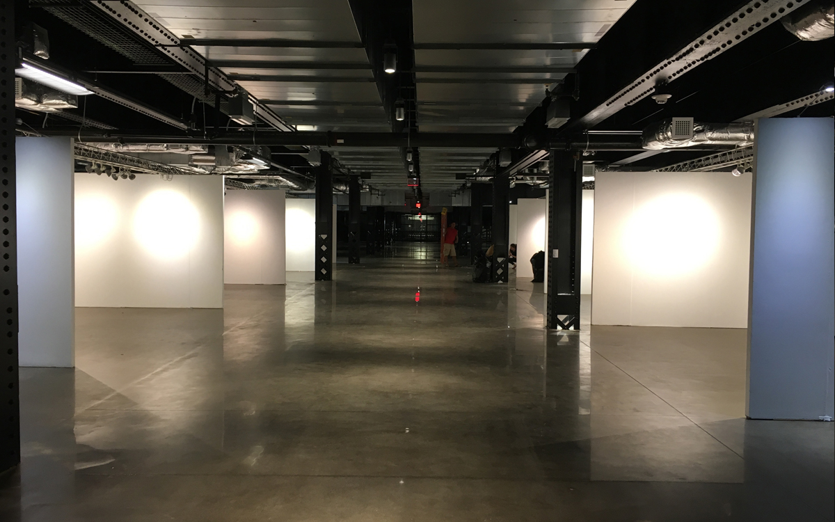 Gallery wall display rentals with truss lighting in urban setting