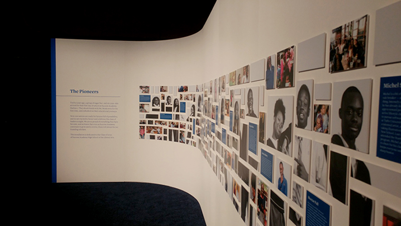 Curved rental wall with applied vinyl graphics and hanging photo montage