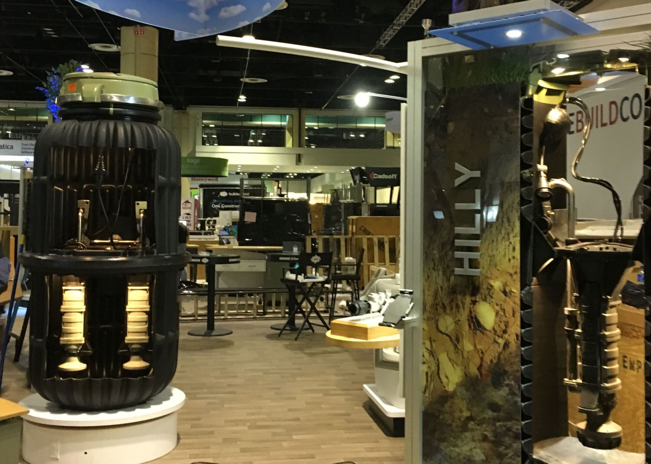 Trade show booth with custom built aluminum display with puck lighting and graphics