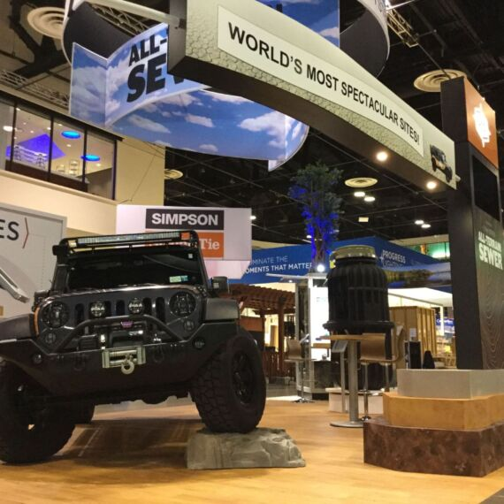 Trade show booth with Jeep, tower with monitor and graphic headers for EOne Sewer Systems