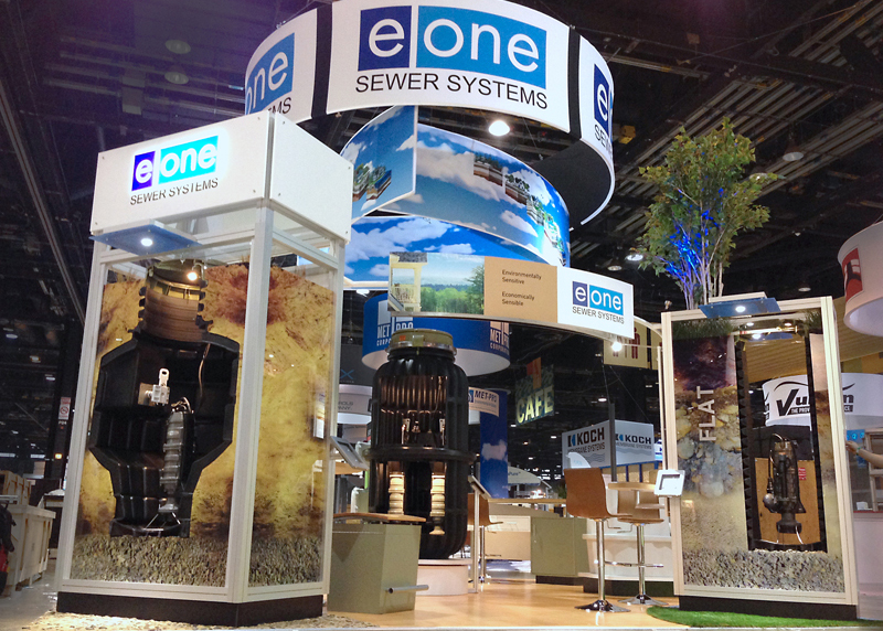 EOne trade show booth with custom built display pods and hanging headers