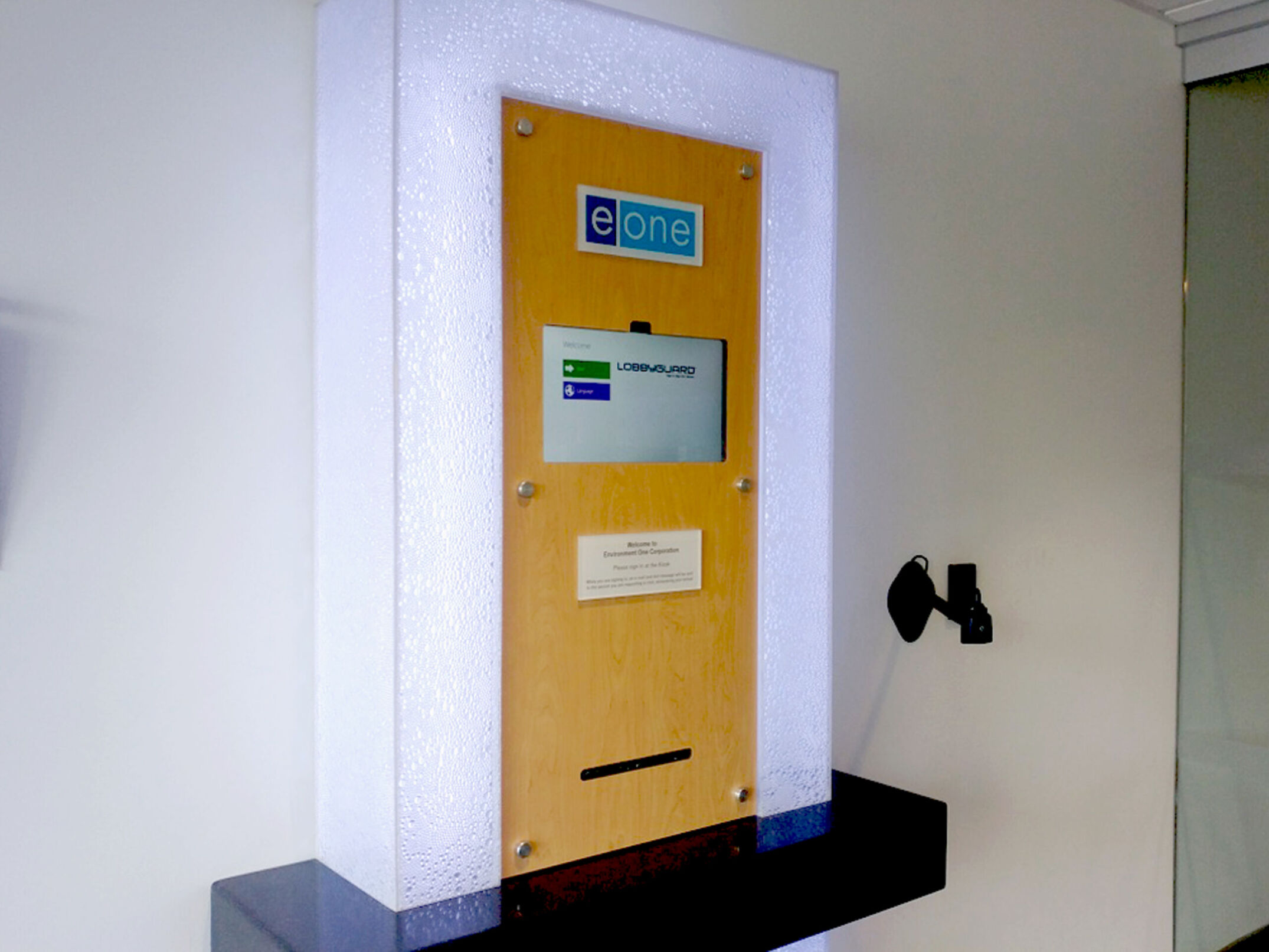 EOne lobby kiosk with monitor and lighted acrylic