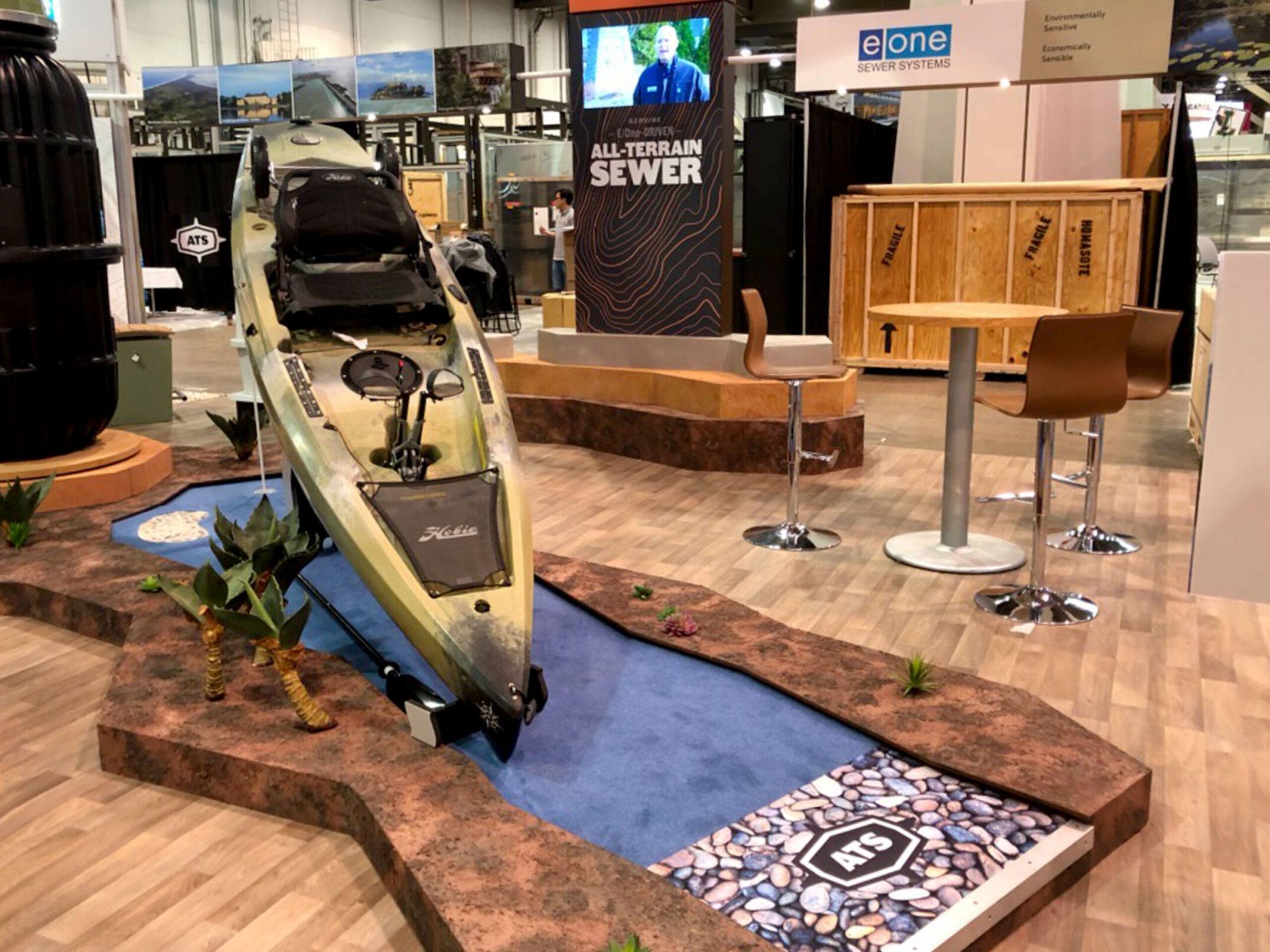 Mini Golf hole with kayak and display with concealed monitor for EOne trade show exhibit booth